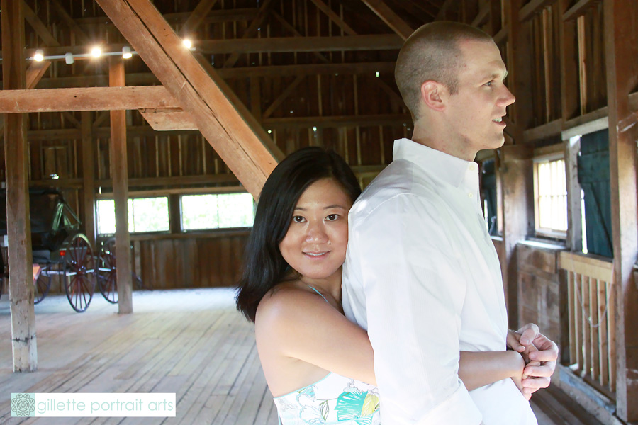 girl hugging guy looking at camera in combsberry inn barn md