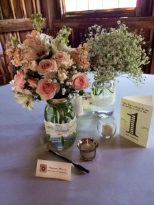 wedding reception flowers on table in mason jars