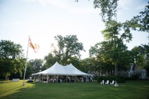 wedding guests sitting under white tent at combsberry inn