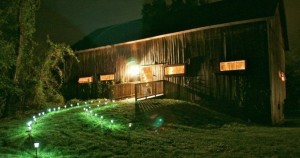 rustic barn lit up at night combsberry inn oxford