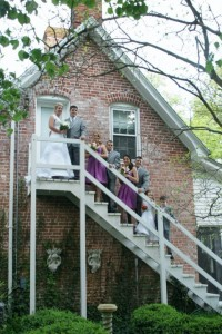 bridal party posed on staircase for wedding photos in oxford md