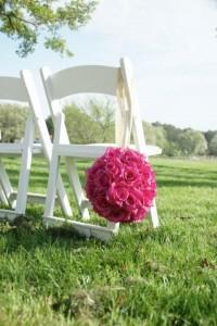 pink bouquet of flowers hanging on white chair on lawn combsberry inn
