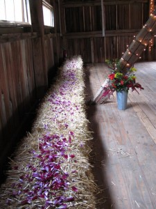 inside of barn decorated for wedding reception