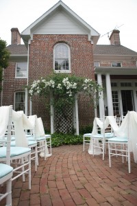 chairs with fabric draped for wedding ceremony by main combsberry house