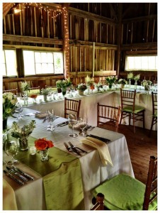 tables with linens and flowers and set up for wedding reception combsberry inn barn