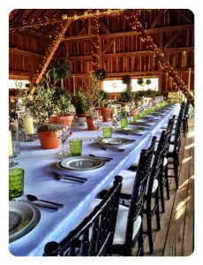 table all set and decorated for wedding reception in barn