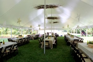 wedding tent before reception with tables set up and stars hanging