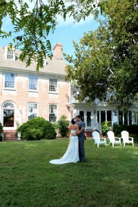 wedding couple in front of main house at combsberry inn oxford md