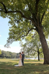 wedding couple posing by large tree near water combsberry inn