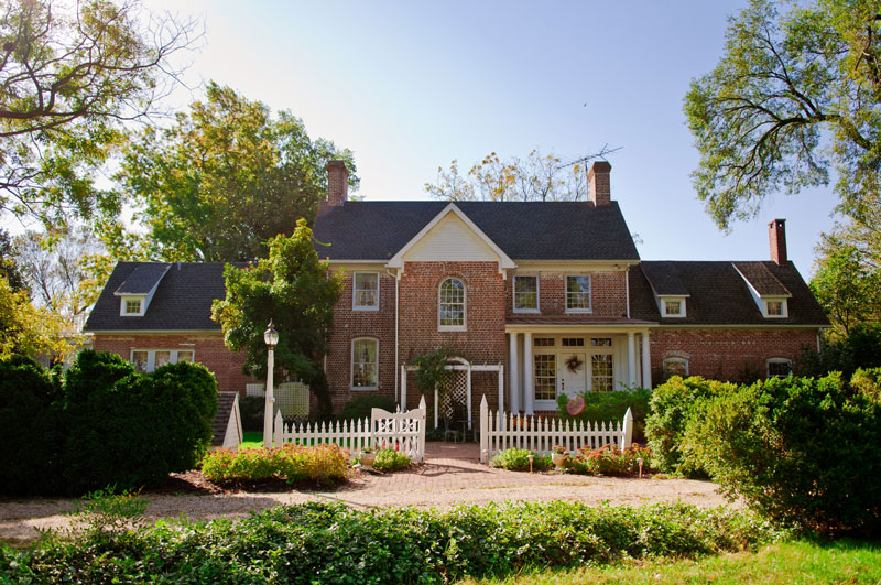 brick house with white picket fence in oxford maryland