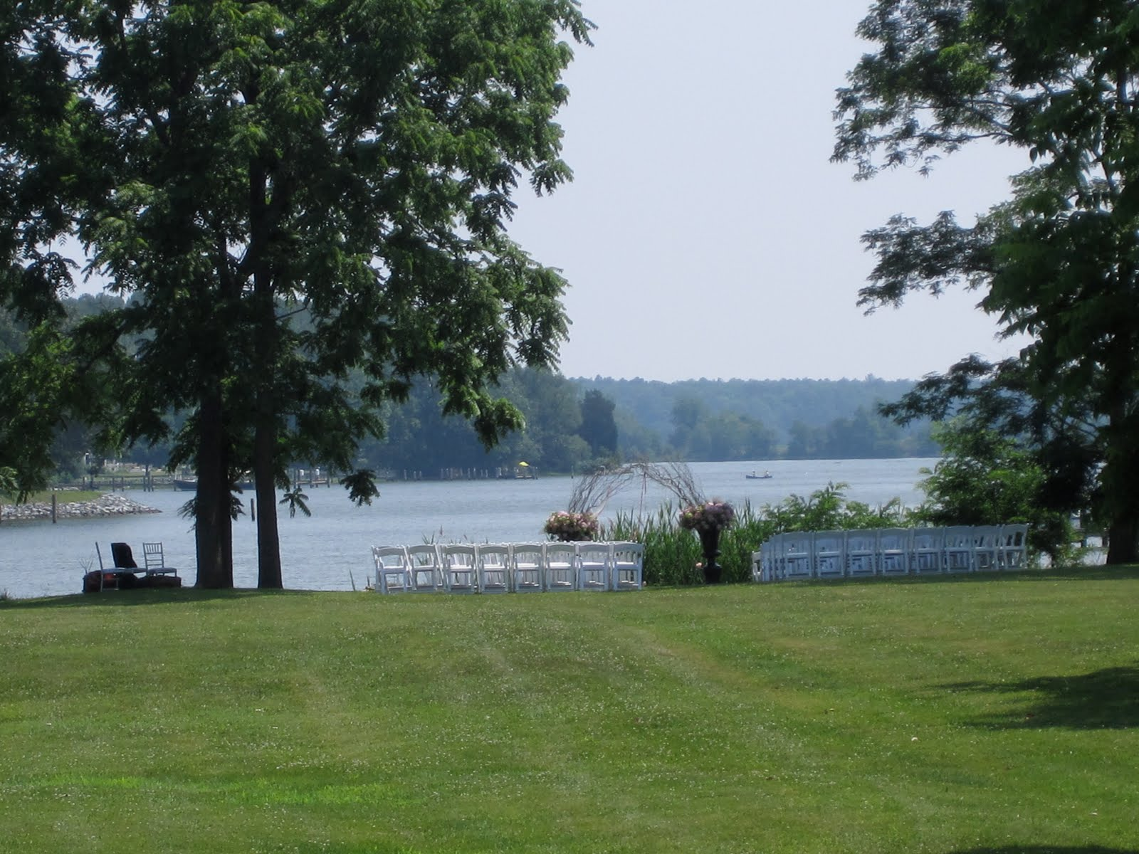 chairs set up for outside wedding by water at combsberry inn