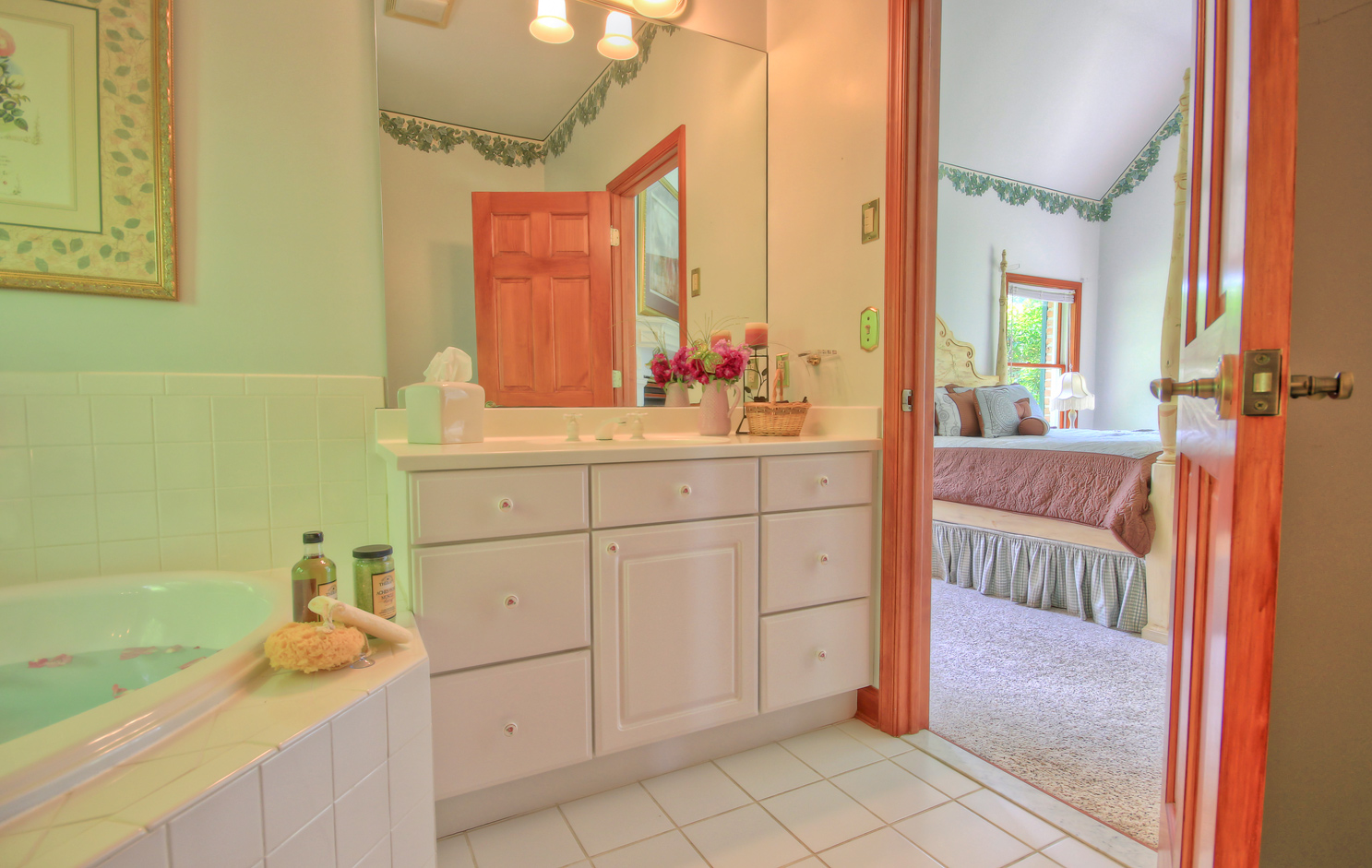 view of queen ann room from bathroom with jacuzzi tub and vanity