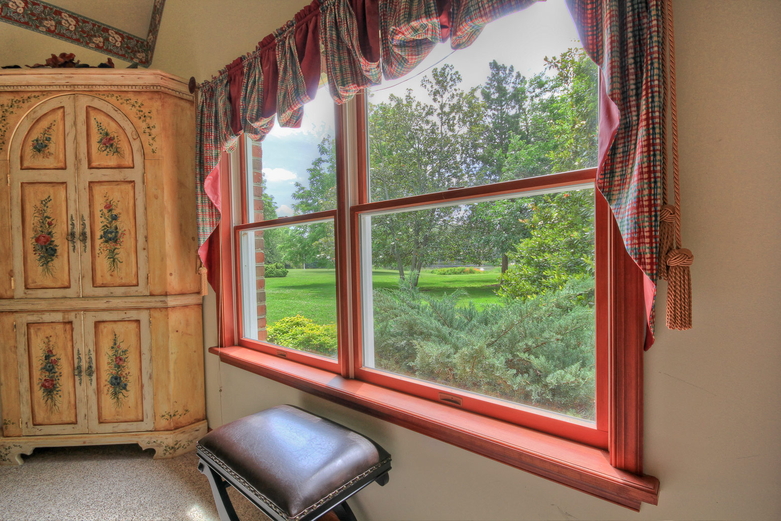 two windows by dresser in eden room overlooking grass and trees at combsberry inn