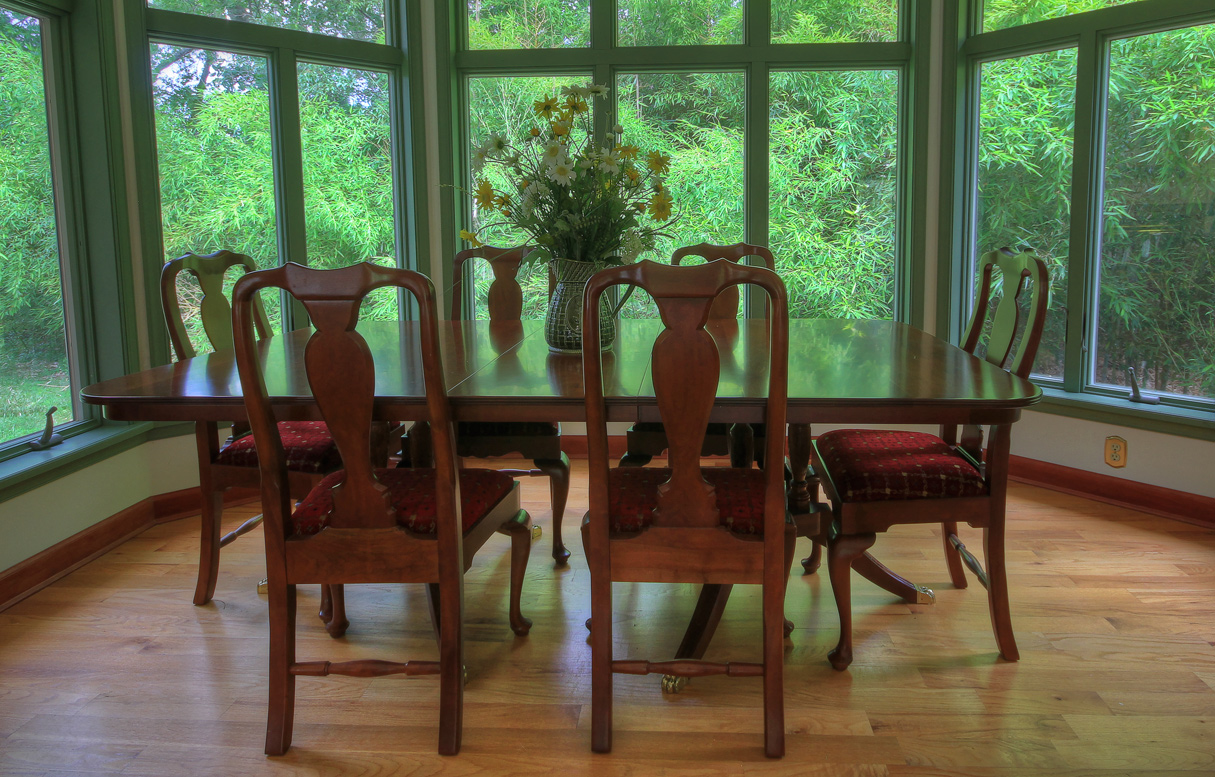 dining room table at combsberry inn surrounded by windows
