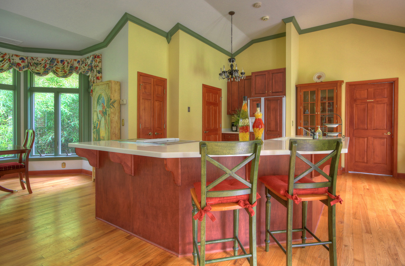 kitchen island area with bar stools in main house at combsberry inn