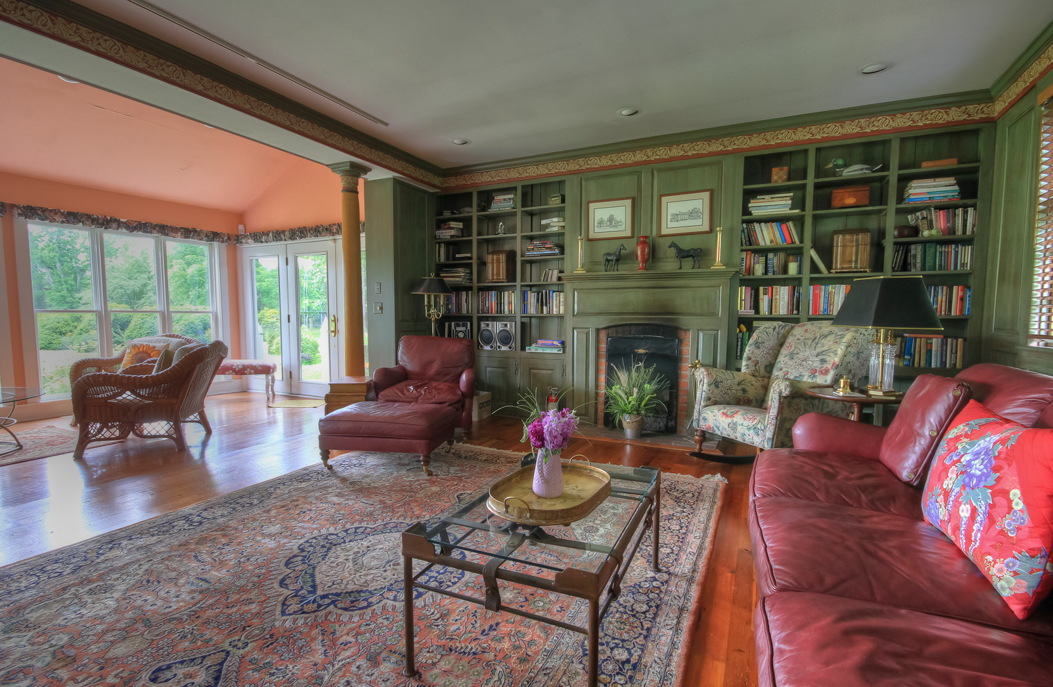 large open room in library at combsberry inn with couch and multiple recliners