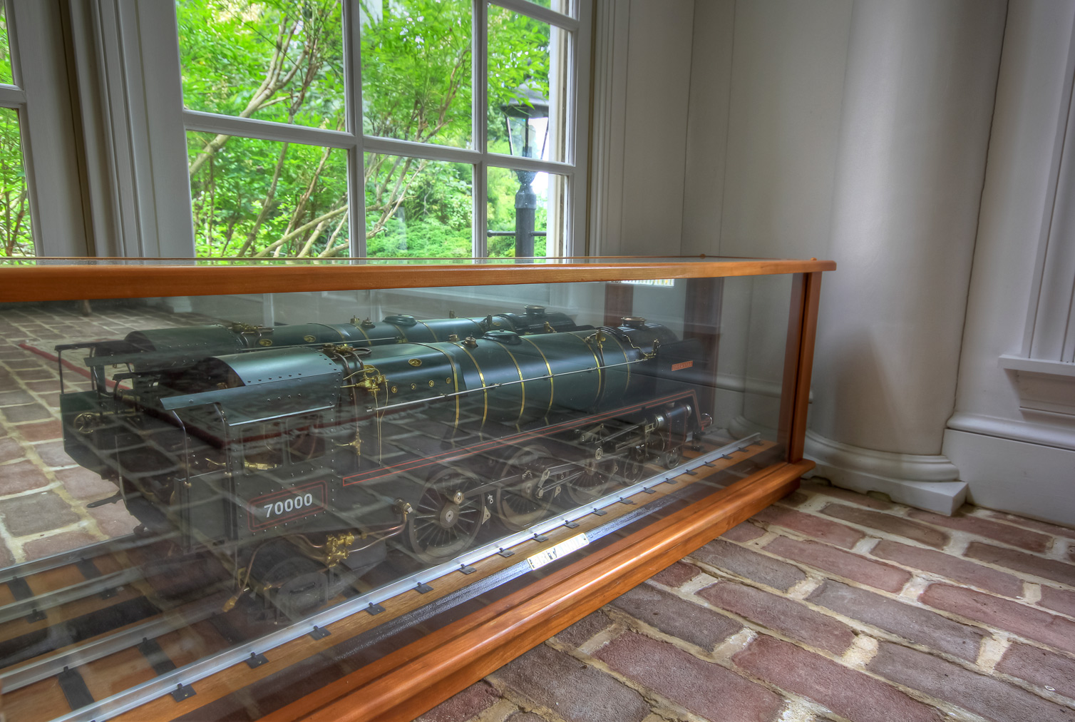 train displayed in glass case in combsberry inn main building
