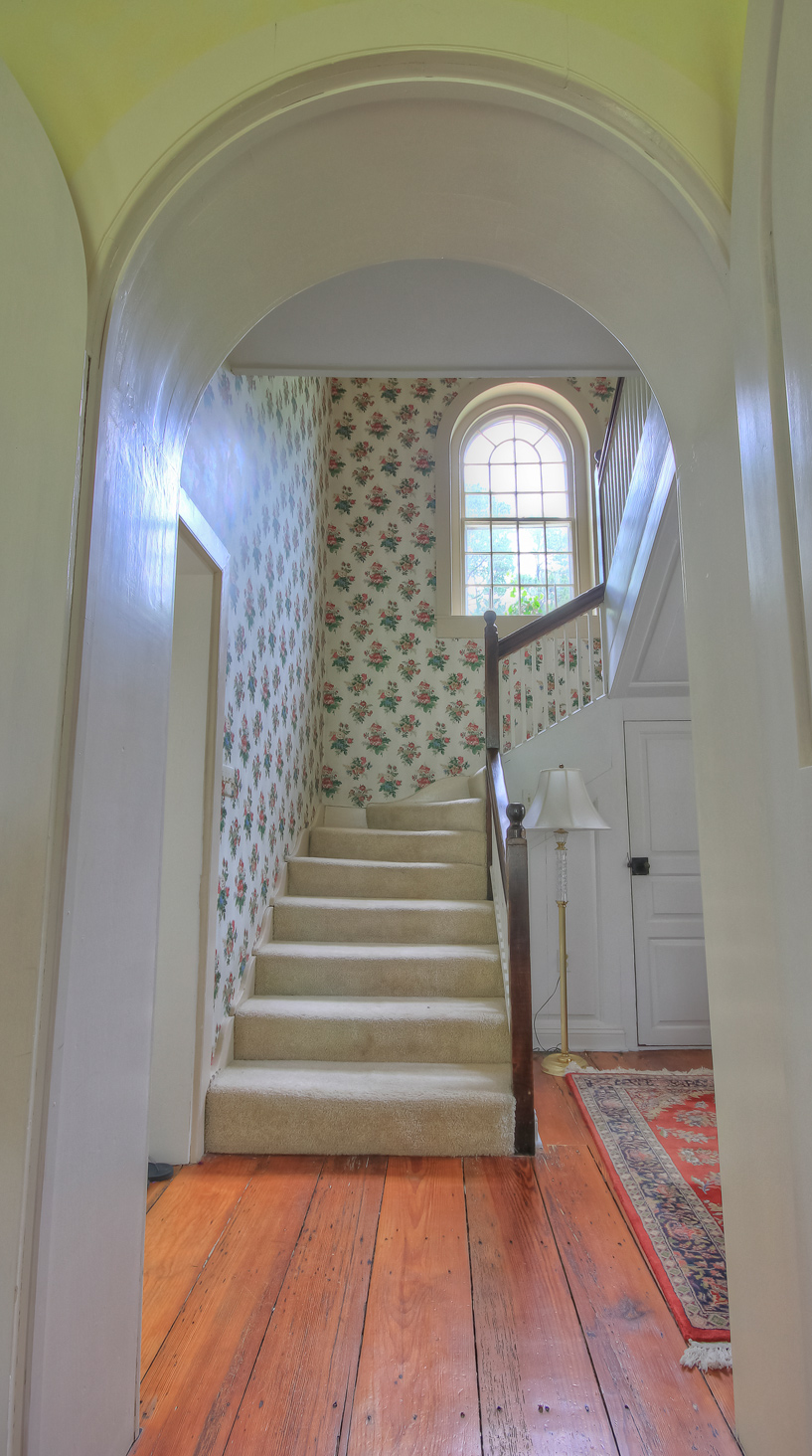 carpeted staircase leading to upstairs room at combsberry inn