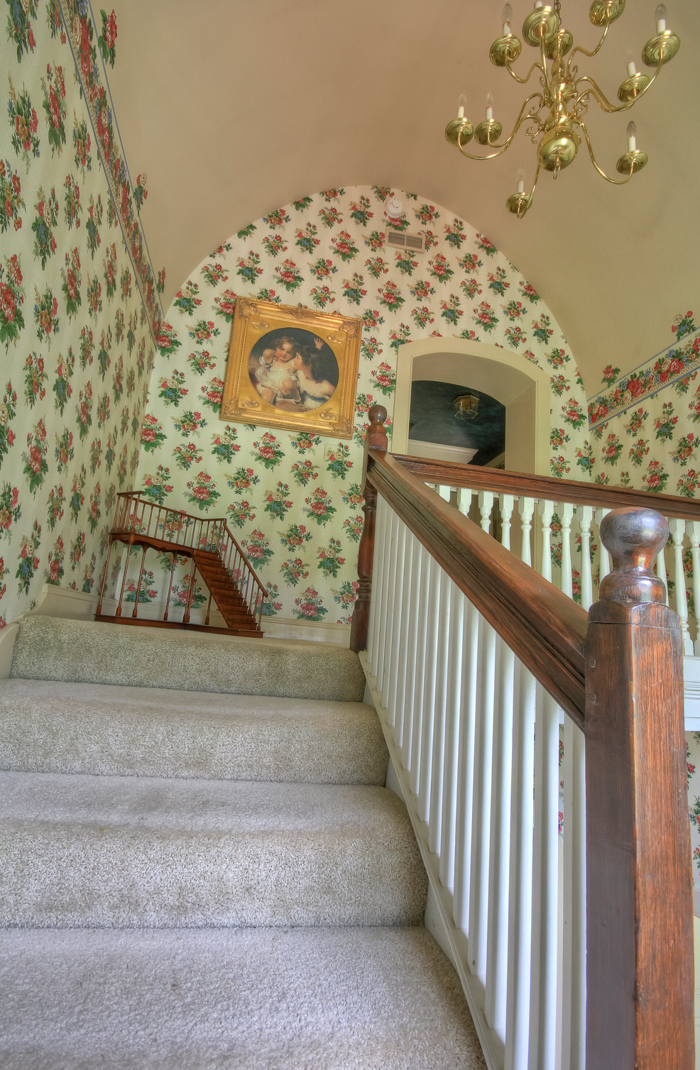 main staircase going upstairs at combsberry inn