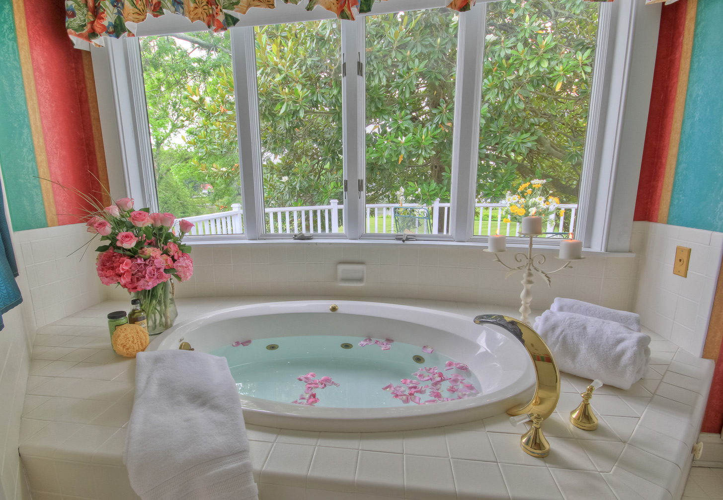 bathroom in suite of combsberry inn room with jacuzzi bath with rose petals