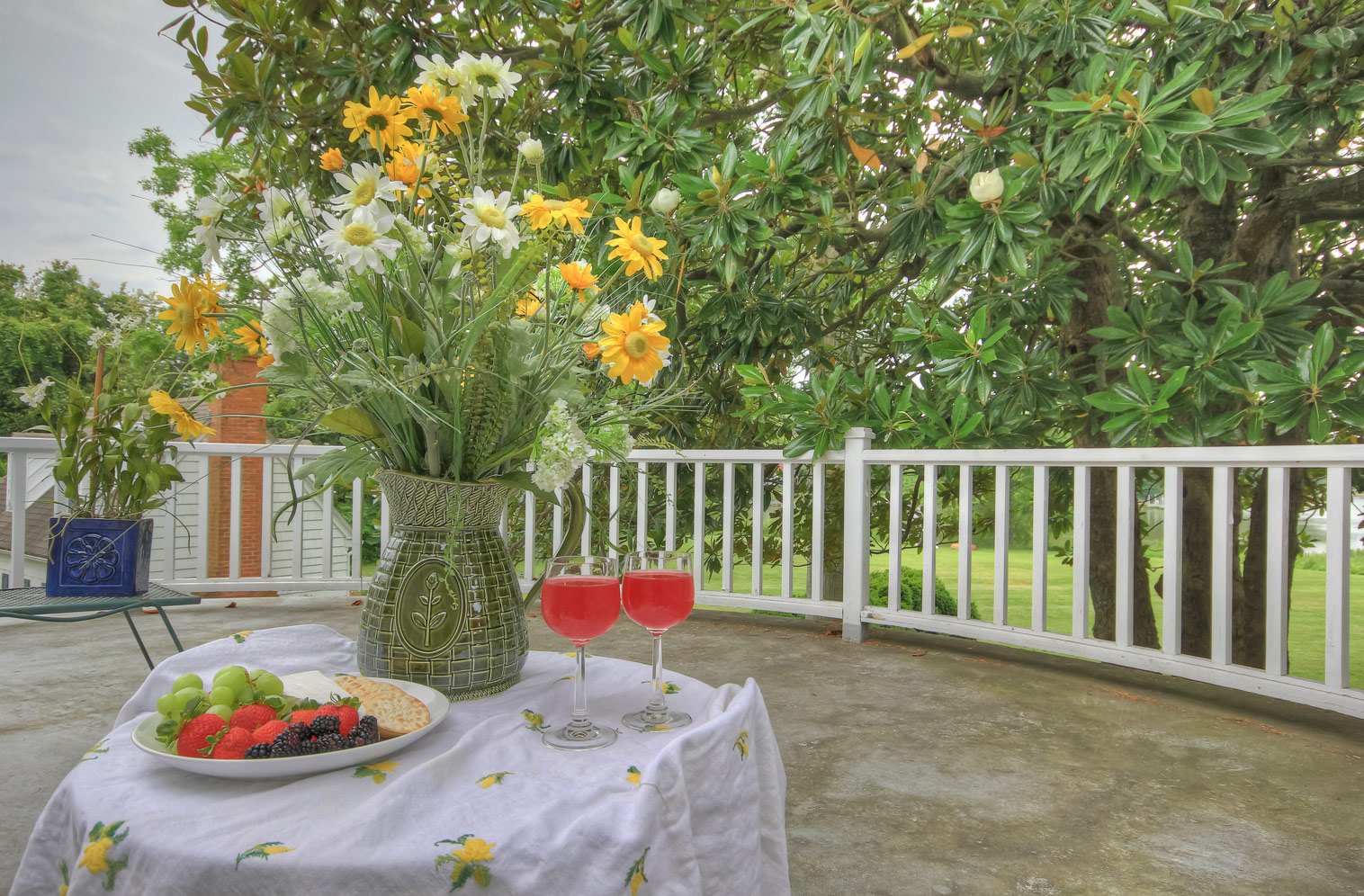 back deck table from room suite with wine fruit and cheese and flowers