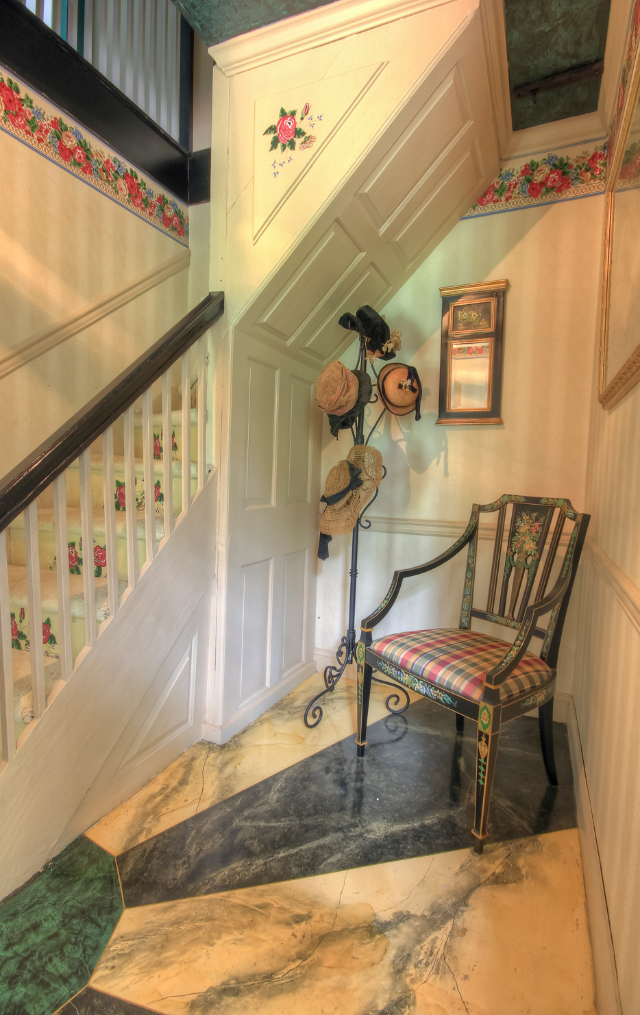 single chair in corner with hat rack by staircase in combsberry inn
