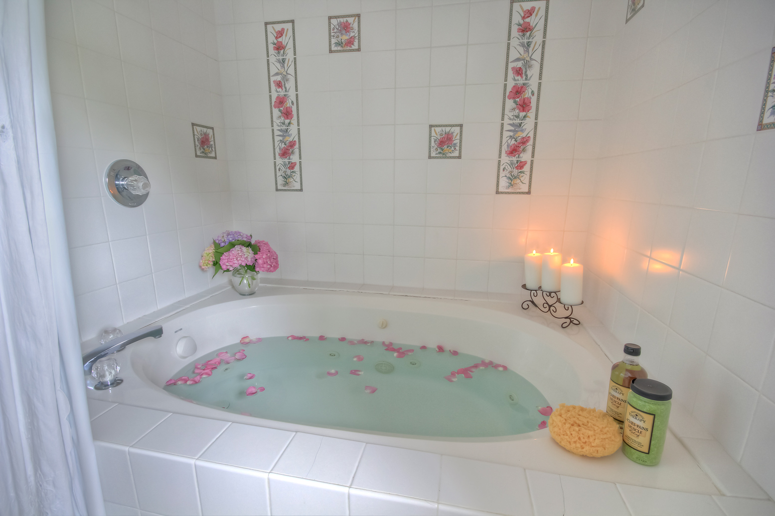 drawn bath with rose petals in oxford cottage in maryland