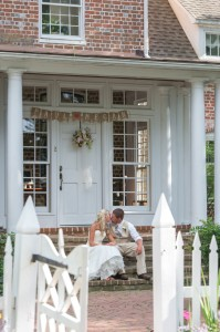 married couple kissing on front steps of combsberry inn m d