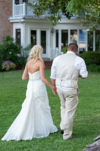 bride and groom walking in front of main combsberry house