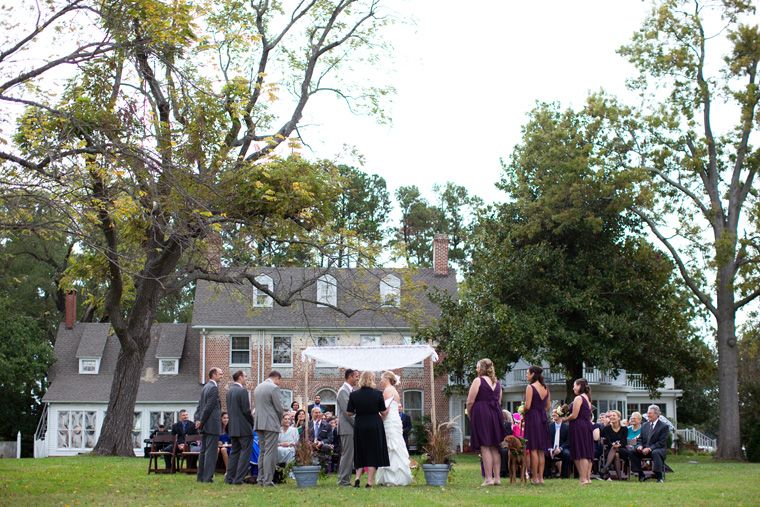guests and wedding couple on lawn in front of combsberry inn
