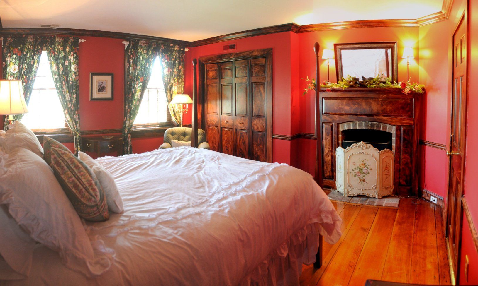 bedroom at combsberry inn with red walls