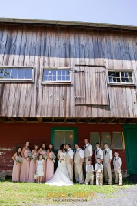 wedding party posed in front of barn in oxford md