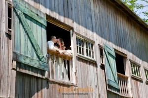 just married couple in window of barn at combsberry inn