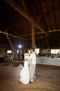 bride and groom dancing in combsberry barn during reception