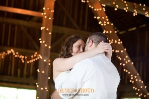 married couple dancing in barn at combsberry inn md