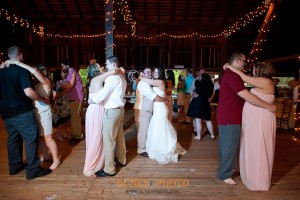 wedding party and guests dancing on dancefloor in combsberry inn barn