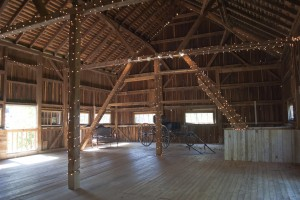barn decorated with string lights for wedding at combsberry inn