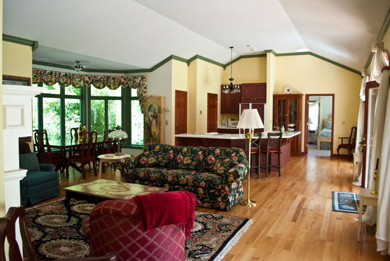 view of living room and kitchen and partial bedroom at combsberry inn