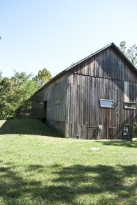 large brown barn used for weddings at combsberry inn md