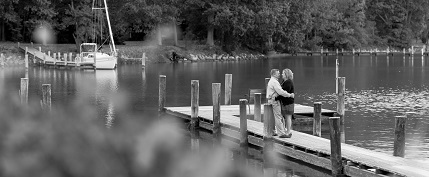 Oxford MD waterfront pier and couple hugging