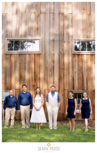 wedding party standing in front of barn at combsberry inn
