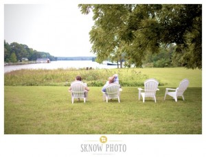 couple sitting in adirondack chairs looking out to water oxford md