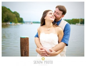bride and groom posed on pier at combsberry inn