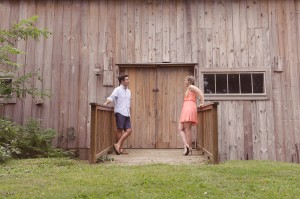 rustic barn in oxford maryland with couple posed in front of door for engagement photo