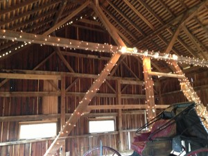 rustic barn beams decorated with white lights