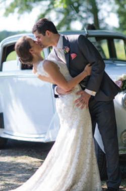 Combsberry wedding couple kissing by car