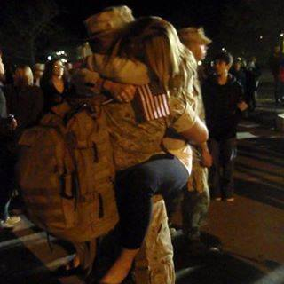 military guy holding woman hugging