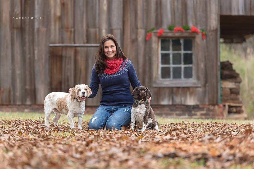 Combsberry Inn Innkeeper Abby Rose posed with two dogs in front of barn