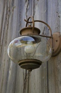 outside latern light hanging on side of building