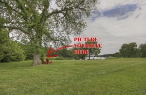 two adirondack chairs by tree and river with picture yourself here and arrow drawn on